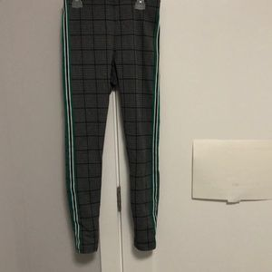 Plaid leggings with white,green, and black stripes